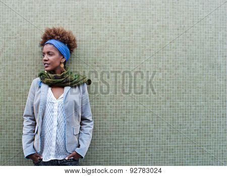 Headshot Of Young Afro American Curly Woman In Front Of Tiled Background - Free Text Space