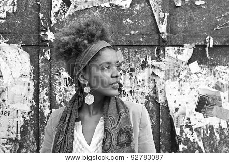 Head Shot Of Young Afro American Woman In Front Of Old Damaged Wall Background- Black And White Phot