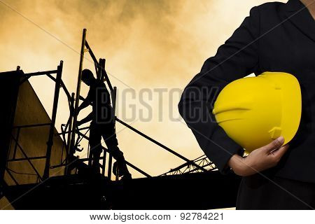 Engineer Holding Yellow Helmet