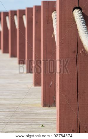 Plank Footpath And Fence Boundary Rope Barrier Closeup