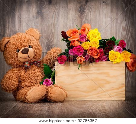 Roses and a teddy bear