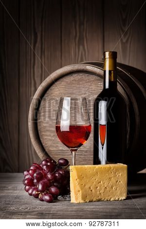 Glass Of Red Wine And Cheese With A Bottle
