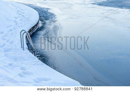 Pool Ladder Close To A Lake During Winter