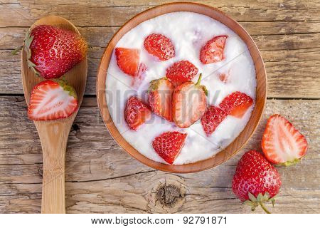 Fresh Organic Yogurt with Strawberries on Wood