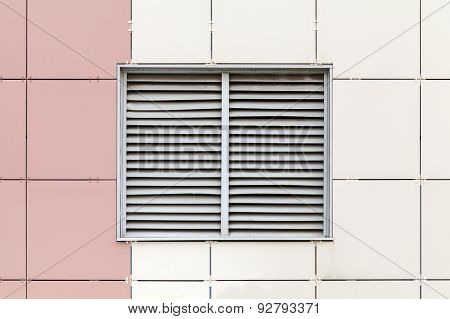 Gray Ventilation Grille On The Window