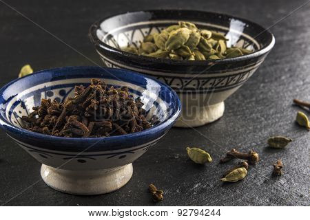 cups of cardamom and cloves