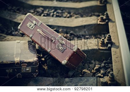 Vintage Suitcases Are Forgotten On Railway Rails.