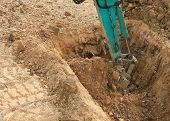 foto of excavator  - excavator tractor working in construction site - JPG