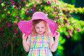 foto of birthday hat  - Little cute girl with flowers - JPG