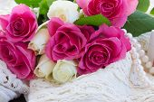 image of mother-of-pearl  - pink and white  fresh roses with lace and pearl jewellery - JPG