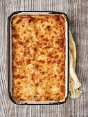 picture of lasagna  - close up of a tray of rustic italian baked lasagna - JPG