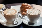 Постер, плакат: Cappuccino With Croissant Two Cups Of Coffee