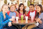 stock photo of pre-adolescent child  - Group Of Children Hanging Out Together In Caf - JPG