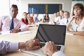 picture of pov  - Point Of View Shot Of Businesspeople Around Boardroom Table - JPG