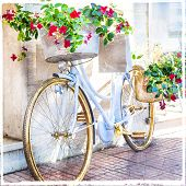 stock photo of charming  - charming street decoration with bike and flowers - JPG