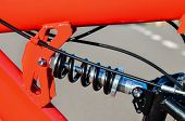 picture of suspension  - Close up of Modern Red Full Suspension Mountain Bike MTB Bicycle - JPG