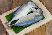 pic of steam  - Steamed mackerel or tuna steamed on wooden background - JPG