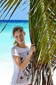 picture of racy  - Girl near palm trees on the beach in the Maldives - JPG