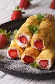 picture of crepes  - crepes with strawberries and cream cheese on a plate close - JPG