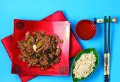 pic of stir fry  - Vietnamese beef stir fry served on a blue background - JPG