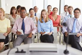 picture of pov  - Business Delegates Listening To Presentation At Conference - JPG
