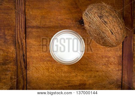 Coconut milk and coconut on a wooden table