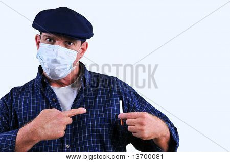 Man in mask pointing at cigarette