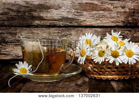 Chamomile tea. Medicinal infusion in a transparent Cup and camomile