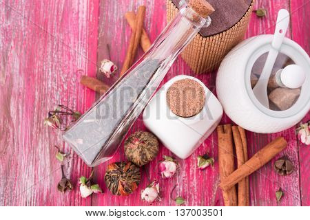 dry tea leaves cinnamon and on wooden background