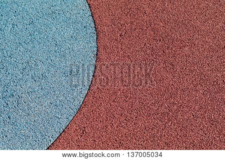 Rubber play ground floor surface covering colorful blue and red curved shapes