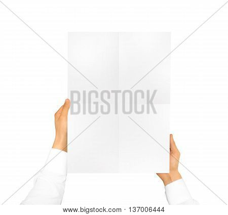 Hand holding poster mock up. Nice mockup to show your design, picture or illustration. Blank sheet hold in hands isolated on white background. Display movie theatre cinema film with poster holder.