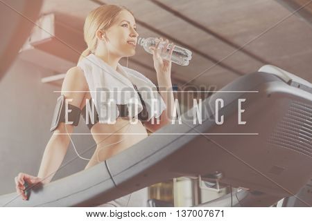 Endurance and stamina. Inspiration words on image of fit women running on treadmill and drinking water in modern gym background