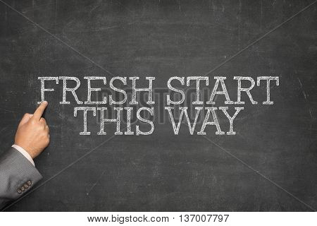 Fresh Start This Way text Business text on blackboard with businessman hand pointing