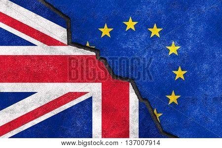 Brexit concept. United Kingdom UK flag on broken wall with European union EU flag.