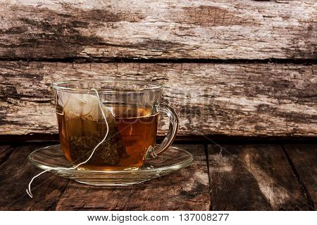 Herb tea. Tea bag in a transparent cup with boiling water