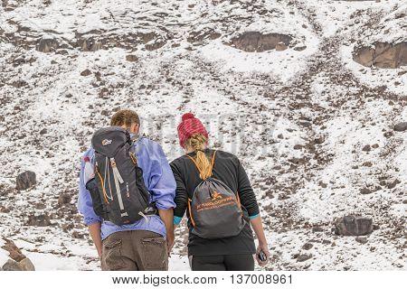 CHIMBORAZO, ECUADOR, OCTOBER - 2015 - Young couple climbing climbing the chimborazo mountain in Ecuador South America