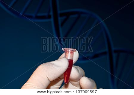 DNA testing of the blood in the laboratory. The tube of blood on the context of DNA.