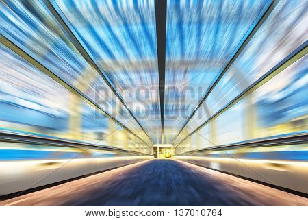 blur motion of empty corridor with abstract glass ceiling in tokyo