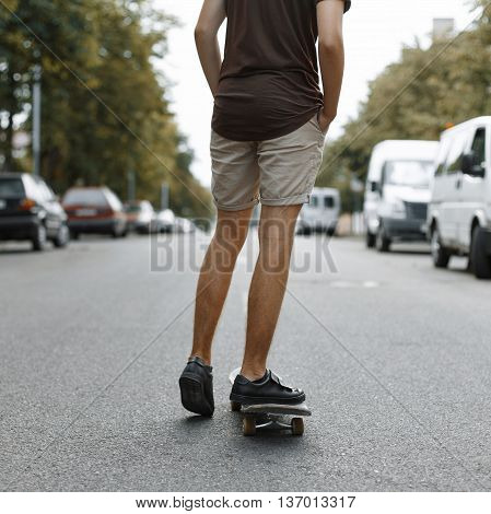 Man Riding On A Skateboard. Legs On A Skateboard.