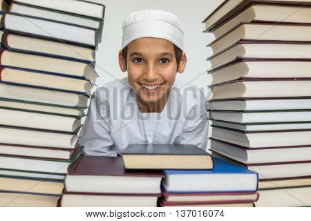 Muslim Arabic kid in library with books