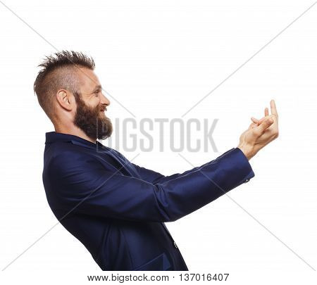 Side view portrait of young bearded man, laugh, show middle fingers, isolated on white background. Emotional man find ridiculous, disrespect and humiliates someone