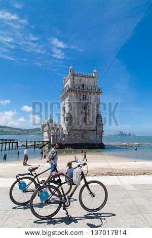 Lisbon Portugal - June 6 2015. A sunny afernoon in Lisbon (Portugal) with the Belem Tower in the background and two bikes in the foreground.