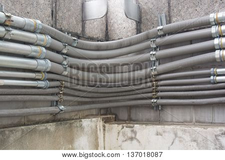 Row of cable conduit installed on the wall