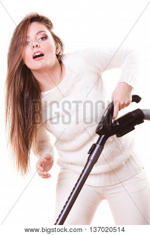 Woman vacuuming the house. Funny girl with vacuum cleaner. Housework