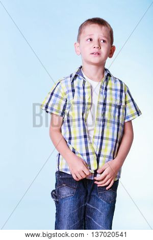 Fitting garment for kids independence. Boys stand alone fastening shirt. Prepare for adolescence trying new clothes.