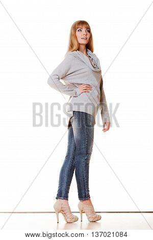 Fashion. Full body blonde fashionable woman jeans pants gray blouse. Female model standing isolated studio shot