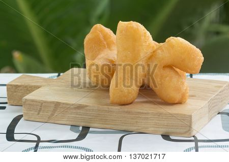 deep fried dough stick on the wooden tray