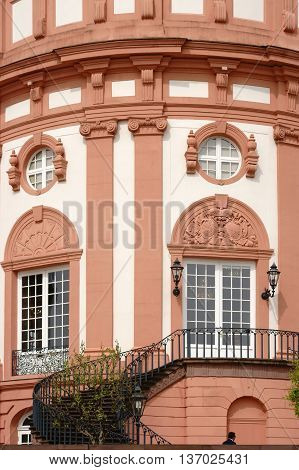 WIESBADEN, GERMANY - APRIL 21: The detail view of a curved staircase to the front view of the castle Biebrich on April 21, 2016 in Wiesbaden.