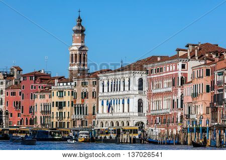 VENICE ITALY - APRIL 29 2016: View of the Grand Canal and the bell tower of the Saint Bartholomew church built in 1747-1754 based on designs of Giovanni Scalfarotto.