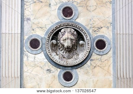 Lion of St. Mark on the facade of the medieval Scuola Grande di San Marco in Venice Italy